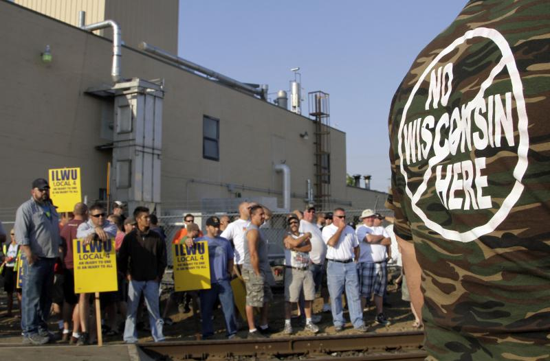 A crowd of union workers and supporters gather at a crossing in Vancouver, Wash., on Wednesday. Hundreds of Longshoremen were at the crossing as part of an escalating dispute about labor at the EGT grain terminal at the Port of Longview, Wash.