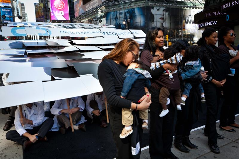 People attend a 'Health Workers Count' event sponsored by Save the Children in New York's Times Square to raise awareness of the importance of midwives and local healthcare providers in developing countries ahead of the Unite Nations General Assembly.