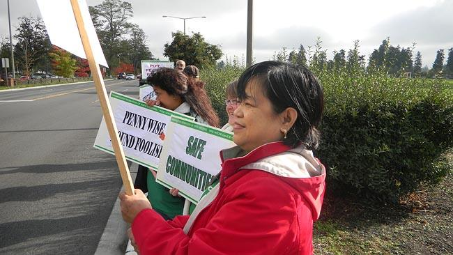 Western State Hospital nurse Celia Gorski joins a picket to protest the proposed closure of five wards in a cost-cutting move.