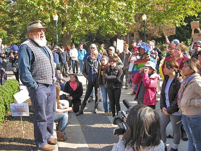 Adjunct Professor of Sociology Chuck Hunt addresses Occupy Eugene Protestors at the U of O Thursday during a rally.""
