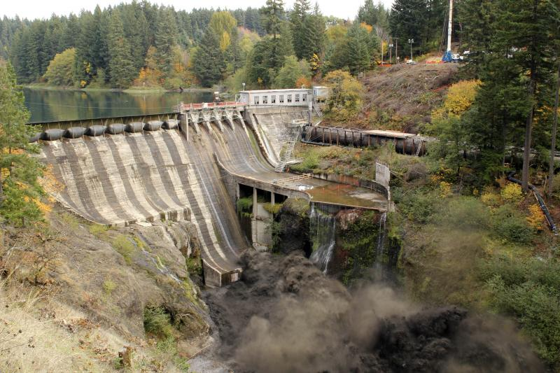 In this photo provided by PacifiCorp., a hole is breached in the century-old Condit Dam on the White Salmon River near White Salmon, Wash., on Wednesday.
