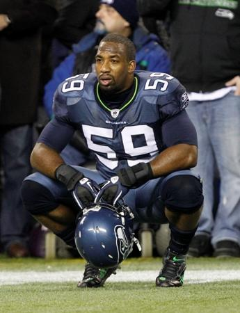 One of the many times Aaron Curry sat on the Seahawks sidelines this year.