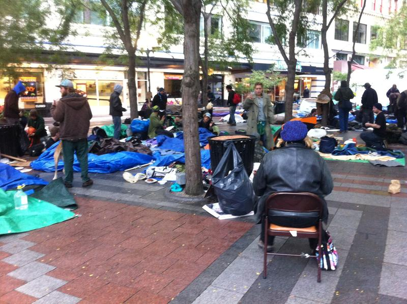 'Occupy Seattle' protesters begin their wet and soggy day on Monday.
