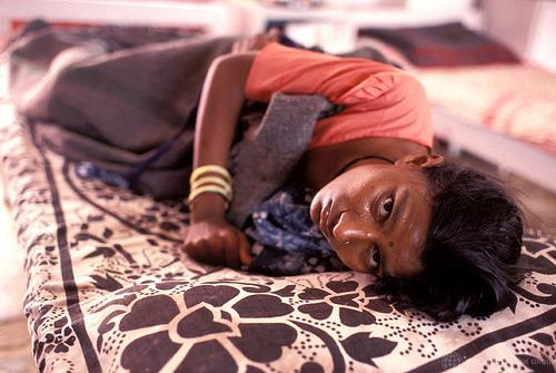 Woman with AIDS in hospital in India.