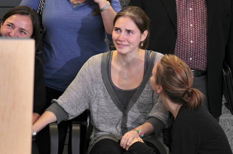 Amanda Knox is surrounded by family members shortly after her arrival at Seattle-Tacoma International Airport on Tuesday in Seattle.