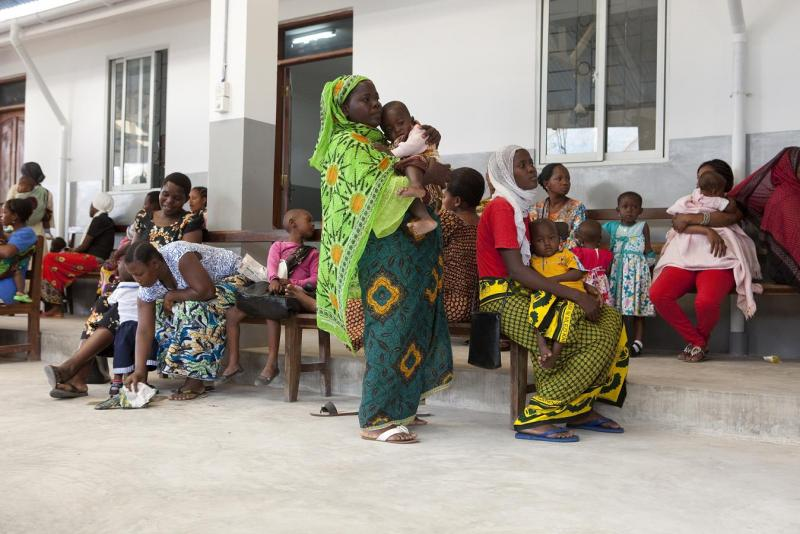 Children in the RTS,S malaria vaccine trial wait with their parents at a hospital in Tanzania on June 28, 2011.