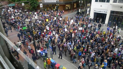 Protesters crowd Portland streets in support of Occupy Wall Street protests.  Many Portland protesters spent the night in parks as Portland Police decided not to enforce no camping laws.
