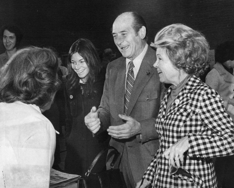 In this file photo, date and location not known, former Washington Gov. Al Rosellini, second from right, votes as his wife, Ethel, right, and his daughter, Lynn, third from right, look on.