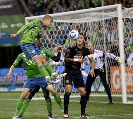 Seattle Sounders' Osvaldo Alonso applies a defensive header near the goal during an Oct. 8 match against the Philadelphia Union in Seattle.