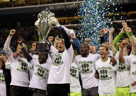 Sounders goalkeeper Kasey Keller holds the U.S. Open Cup as he celebrates with his teammates this month in Seattle, after they won the Open Cup for a third year in a row. Will the team's first MLS Cup be next?