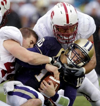 Then-UW quarterback Jake Locker is sacked during last year's 41-0 loss to Stanford at Husky Stadium. The Huskies are hoping for a better outcome Saturday when they play the Cardinal. But Stanford QB Andrew Luck has been unbeatable so far this season.