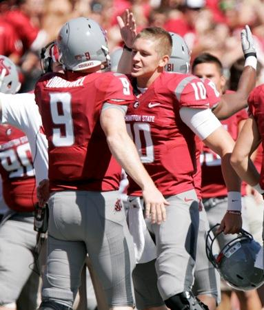 WSU's Jeff Tuel (10) congratulates Marshall Lobbestael (9) after a touchdown against Idaho State last month. Tuel broke his collar bone in the game. Lobbestael has played well, leading to a potential controversy now that Tuel has recovered.