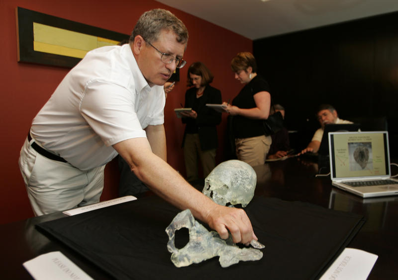 Dr. Doug Owlsley, left, of the National Museum of Natural History at the Smithsonian Institution, arranges the pieces from the model of the Kennewick Man for a presentation for the media at University Towers in Seattle in 2005.