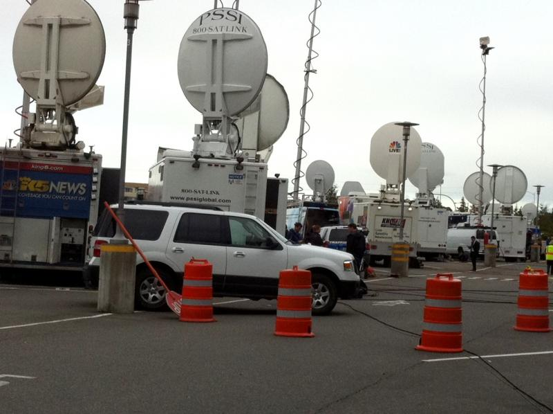 Media from around the world prepare to beam news of Amanda Knox' return to Seattle on Tuesday.