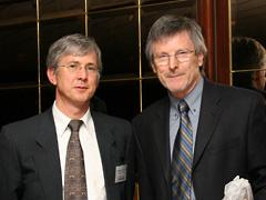 Michael Free, at right, has been made an Officer of the Order of the British Empire.