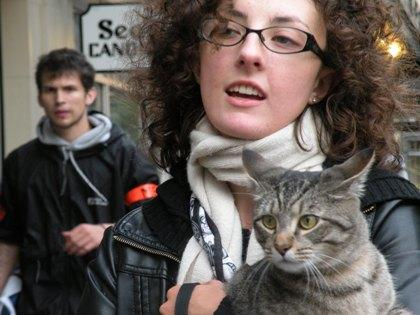 Emily Eddy, an Occupy Seattle volunteer medic, with a cat that one of the protesters has been keeping at the demonstration.