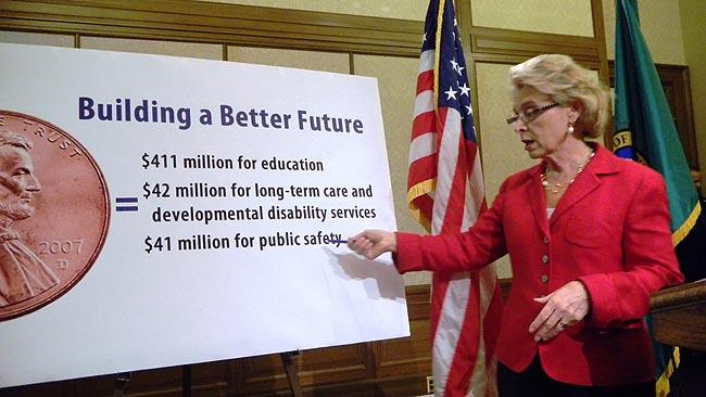 "Gov.Chris Gregoire discusses her half-cent sales tax proposal To ""buy back"" some cuts."