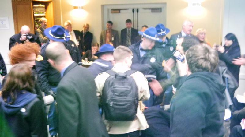"Washington State Troopers remove members of the ""Occupy"" movement who disrupted a senate budget hearing in Olympia."