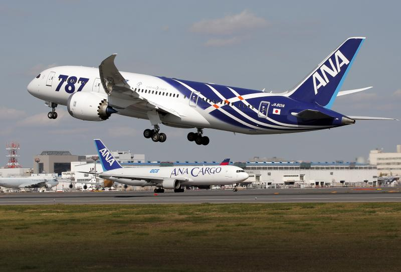 All Nippon Airways Boeing 787 takes off for the airplane's inaugural commercial flight to Hong Kong at Narita International Airport in Narita, east of Tokyo, Wednesday, Oct. 26, 2011.