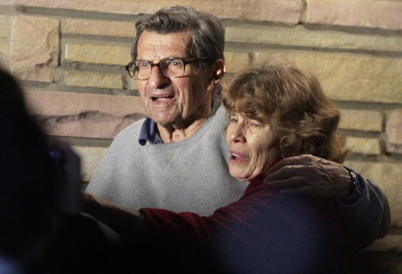 Joe Paterno and his wife Susan stand on their porch to thank well-wishers gathered outside in State College, Pa., Wednesday.