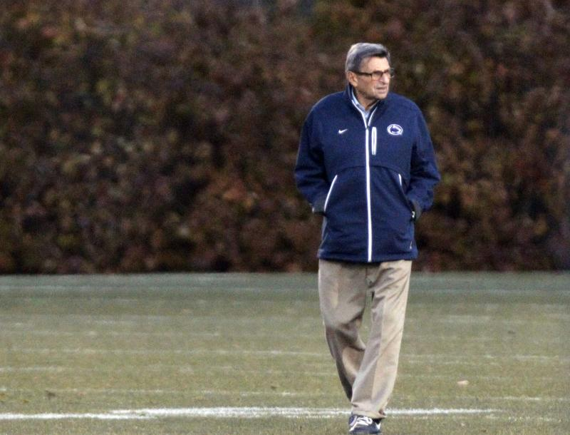 Alone on field for main Penn State coach Joe Paterno looks on during football practice on Wednesday.
