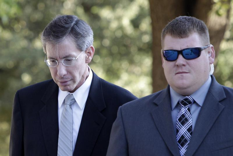 New evidence in Canada point to polygamist religious leader Warren Jeffs, seen here arriving at a courthouse escorted by a law enforcement officer in San Angelo, Texas, earlier this year. Jeffs was convicted in August and sentenced to life.