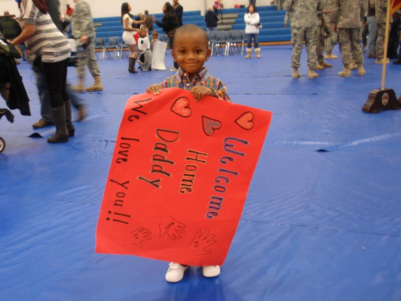Keicher Singleton Jr. awaits his dad from a six month deployment to Iraq.