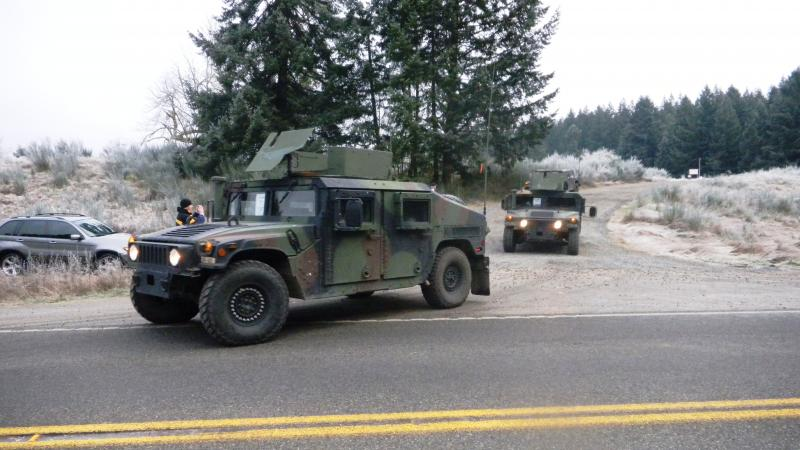 Army Vehicles Leave The Crash Site Near Rainier, Wash.