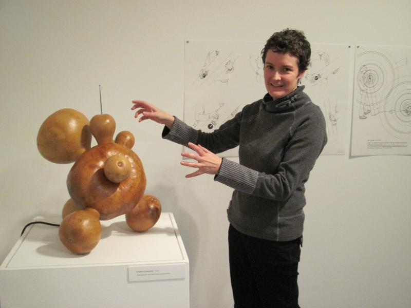 Alison MacTaggart's demonstrates how her giant gourd emits spooky sounds when somebody comes near.