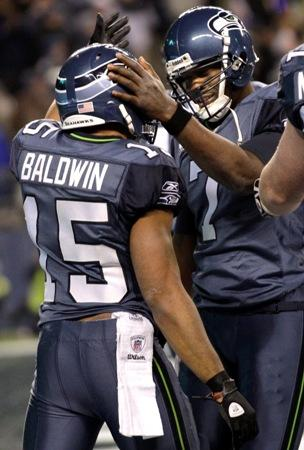 Seahawks quarterback Tarvaris Jackson greets teammate Doug Baldwin after Baldwin scored a touchdown Monday night in Seattle. The Seahawks defeated the Rams 30-13.