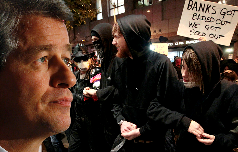 JPMorgan Chief Executive Jamie Dimon and Occupy Seattle protesters, shown in front of a Seattle hotel on Nov. 2, did not meet face-to-face – but the protesters would have liked that.