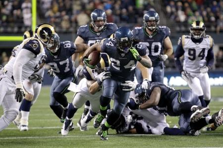 'Beast mode': Seahawks running back Marshawn Lynch evades the St. Louis Rams defense during Monday night's 30-13 rout in Seattle. Lynch is on a roll that could land the Seahawks in the playoffs for the second straight year.