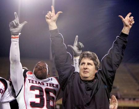 Mike Leach celebrates after Texas Tech beat Minnesota 44-41 in overtime in the Insight Bowl in 2006. Leach took the Red Raiders to a bowl game in each of his 10 years there. WSU officials hope he'll bring his winning ways to Pullman.