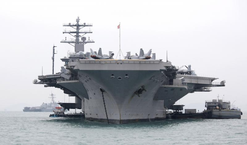Carrying some 5,000 sailors, the aircraft carrier USS Nimitz docks for a port call in Hong Kong water in 2010.