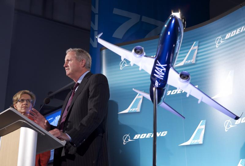 Jim Albaugh, President and CEO of Boeing Commercial Airplanes, talks to reporters about Boeing's plans to build a version of its 737 passenger airplane named the 737 MAX, which feature redesigned CFM International LEAP-1B engines, in August.