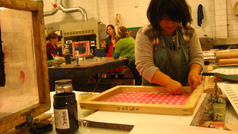 Helen Oh works on a design in a screen printing class at the Pratt Fine Arts Center.