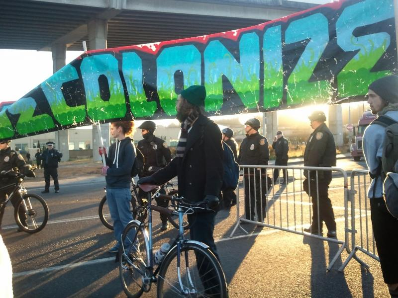 Seattle Occupy protesters confront police near the Port of Seattle's Terminal 18.
