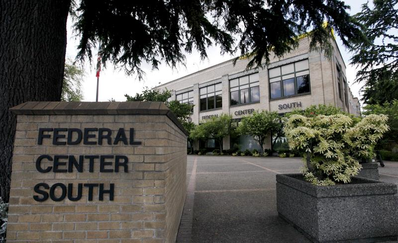 A federal building that houses the Seattle Military Processing Center in Seattle. Two men have been arrested in a plot to use machine guns and grenades in an attack on the military recruiting station there.