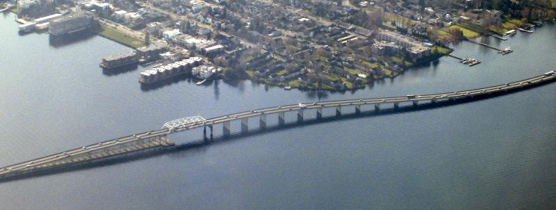 The Highway 520 floating bridge, including the western high rise, where the bridge passes near the Madison Park neighborhood of Seattle as it heads over Lake Washington.