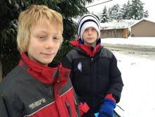 Ben (l) and Michael Hall look a a lot alike (they're identical twins,) but they disagree about the weather. Ben prefers skateboarding to sledding, while Michael loves the snow and building igloos.