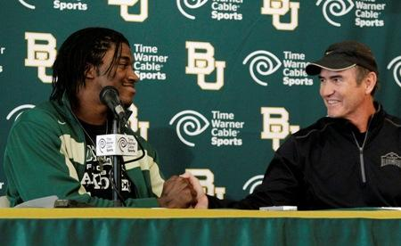 Heisman Trophy winner Robert Griffin III shakes hands with Baylor head coach Art Briles after Griffin announced Wednesday that he would skip his senior year and enter the NFL draft. Do the Seahawks have a chance of getting him? Art Thiel says it's slim.