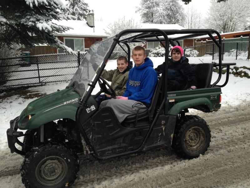 Braden and Scoute Wadell with their friend, Skyler Sanders (r), surveying the neighborhood in an all-weather vehicle.