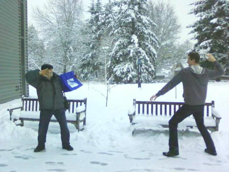 KPLU host Kevin Kniestedt takes aim with a snowball as Dick Stein takes refuge behind the KPLU tote bag.