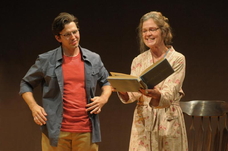 "Tyler Pierce (as Bill Cain) and Linda Gehringer (as Mary Cain) star in the world premiere of Cain's ""How to Write a New Book for the Bible"" at Seattle Repertory Theatre."