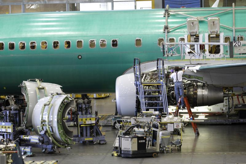 An employee works on the engine of a Boeing Co. 737 airplane last summer at the company's assembly facility in Renton, Wash.