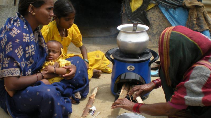 Women in India using an Envirofit clean cookstove to reduce indoor air pollution.