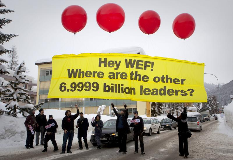 Protesters from the Occupy anti-capitalist movement release a banner reading ' Hey WEF! Where are the other 6.9999 billion leaders?' on the first day of the 42nd annual meeting of the World Economic Forum, WEF, in Davos, Switzerland, on Wednesday.