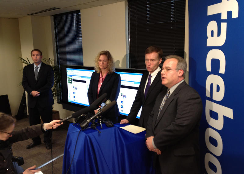 What they DID want us to see: Facebook attorney Craig Clark, right, talks to reporters with Washington Attorney General Rob McKenna, second from right, at the press conference in Seattle on Thursday.