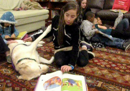 Kids and dogs enjoy books (and each other) at the Brettler Family Place, a housing center in Seattle's Sand Point neighborhood.