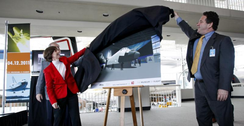 Retired astronaut Bonnie Dunbar, left, and Museum of Flight board chairman Kevin Callaghan unveil in Seattle a rendering of a full-fuselage shuttle trainer that the museum will receive.